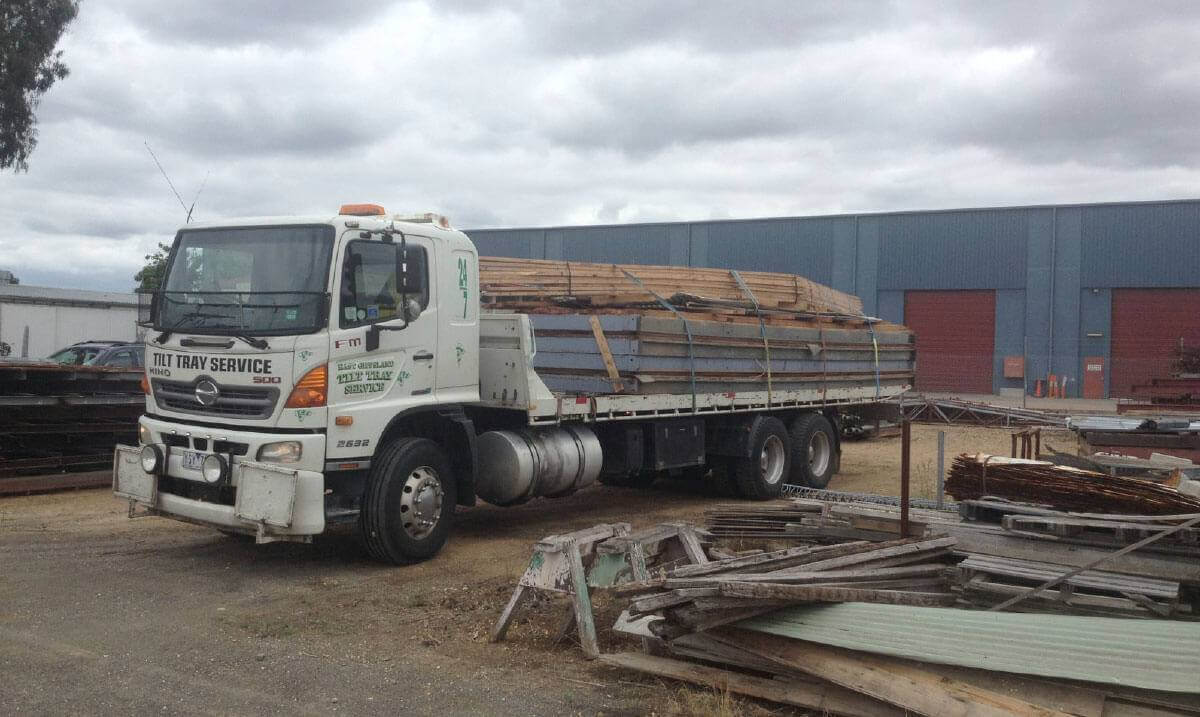 Hire a tilt tray truck to transport oversized timber beams with East Gippsland Tilt Tray Service from Lakes Entrance