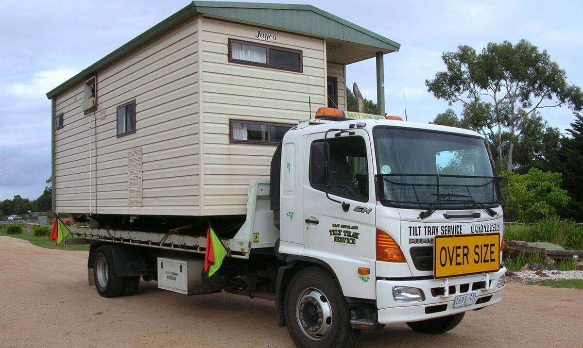 Hire a tilt tray truck to transport a portable home with East Gippsland Tilt Tray Service from Lakes Entrance
