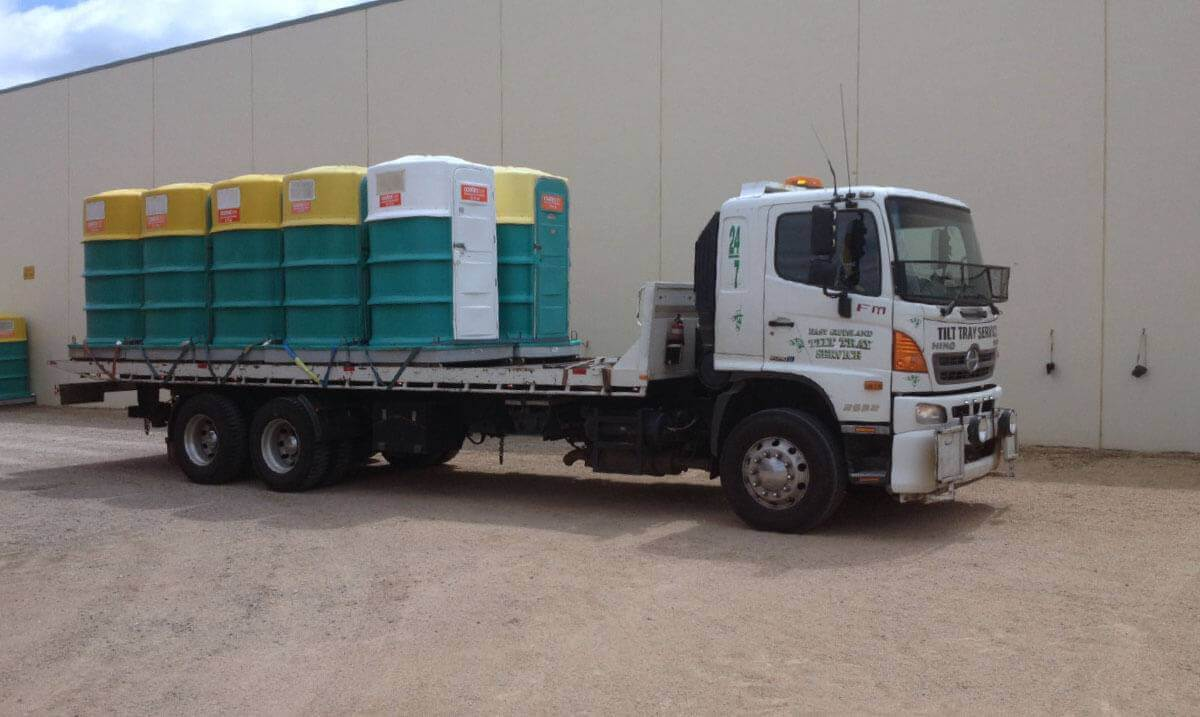 Hire a tilt tray truck to transport a portable toilets with East Gippsland Tilt Tray Service from Lakes Entrance