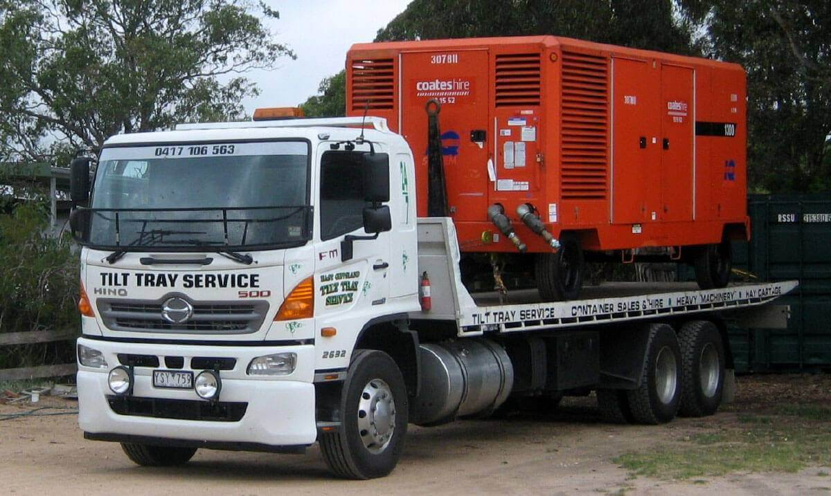 Hire a tilt tray truck to transport an oversized electrical power generator with East Gippsland Tilt Tray Service from Lakes Entrance