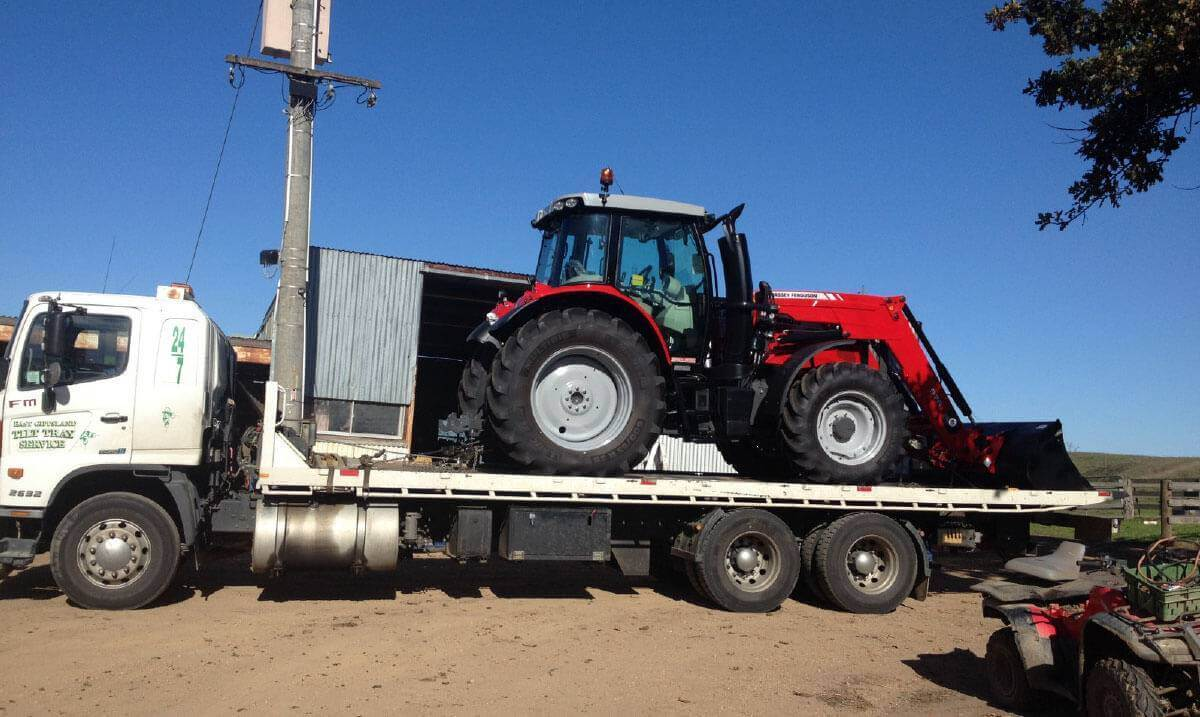 Hire a tilt tray truck to transport a tractor with East Gippsland Tilt Tray Service from Lakes Entrance